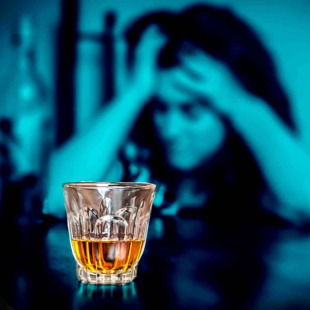 person suffering from alcohol addiction