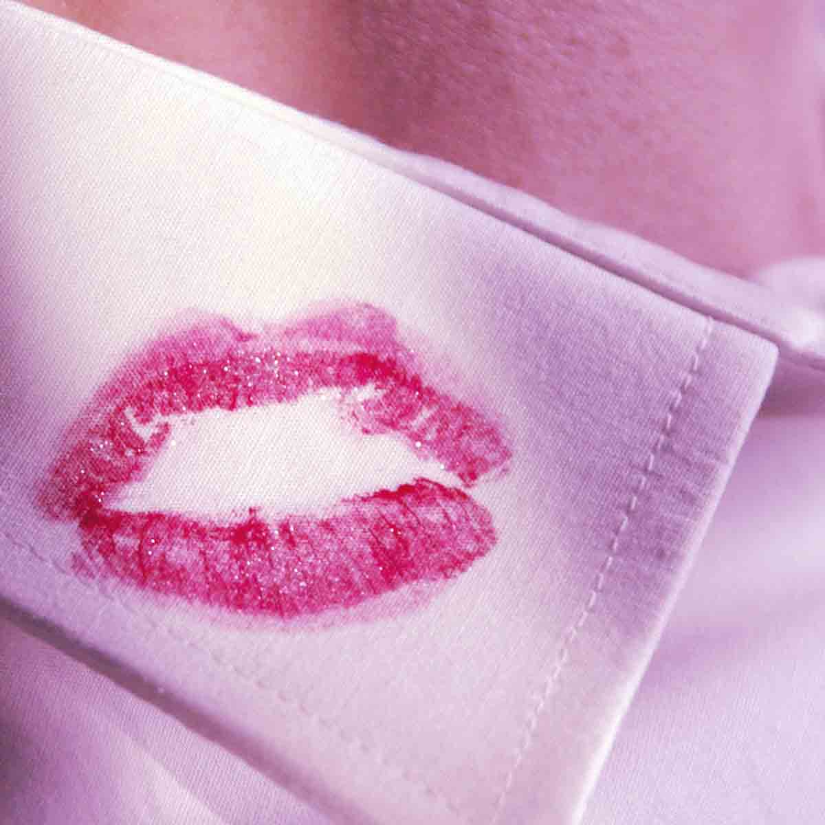 red kiss on mans white shirt collar