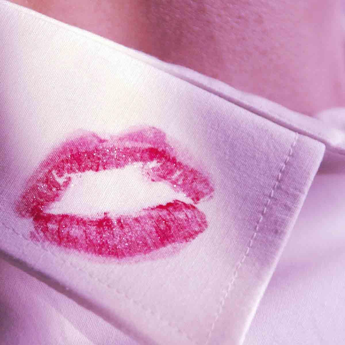 red kiss on mans white shirt collar